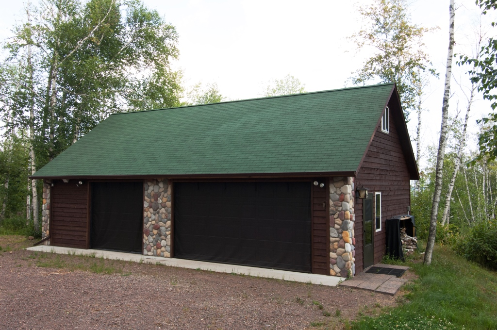 3 Car Garage with Stone Accents