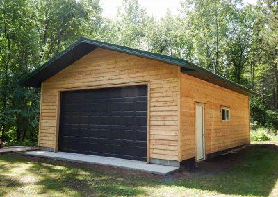 Upgrades Shown Cedar Siding 9′ High Garage Door Aluminum Soffit and Fascia Concrete Apron 2′ Overhangs 10′ Wall 1 Course of Block Ridge Vent