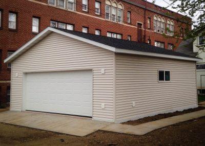 Upgrades Shown Concrete Sidewalk Concrete Apron 4 J-Blocks Foundation Flashing Vinyl Siding 9′ Wall Aluminum Soffit and Fascia Ridge Vent